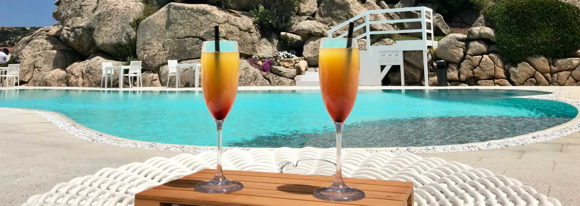 alcohol drinks beside a pool in the caribbean