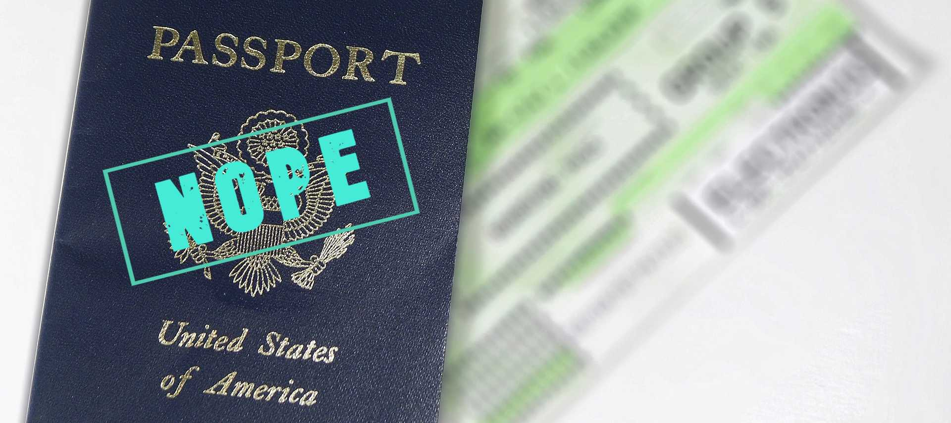 passport with the word nope stamped across it