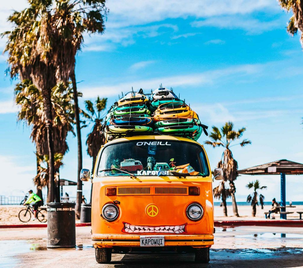 vw van piled high with surfboards