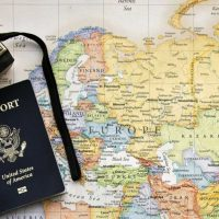map with passport and camera on top