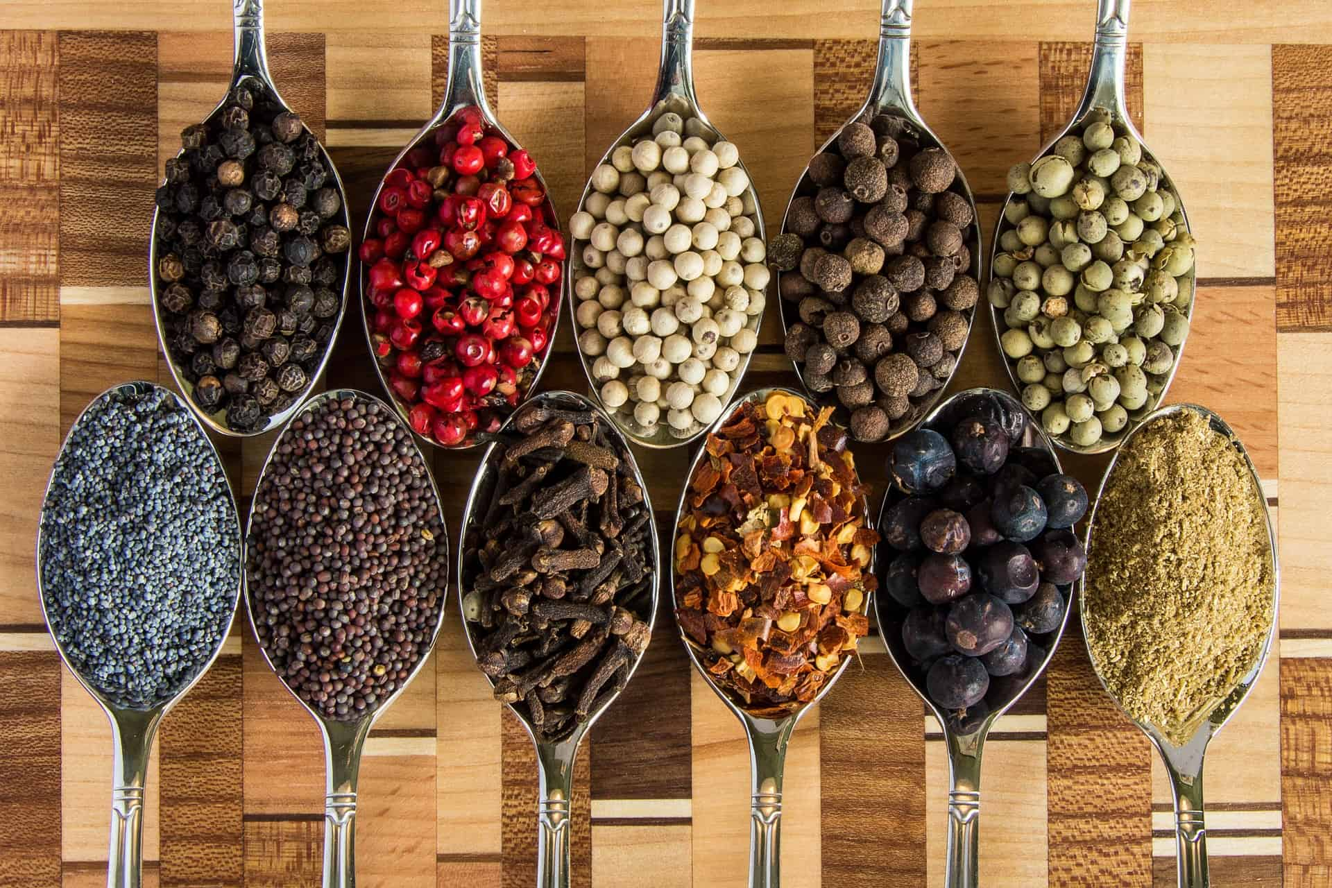 a variety of spices on spoons