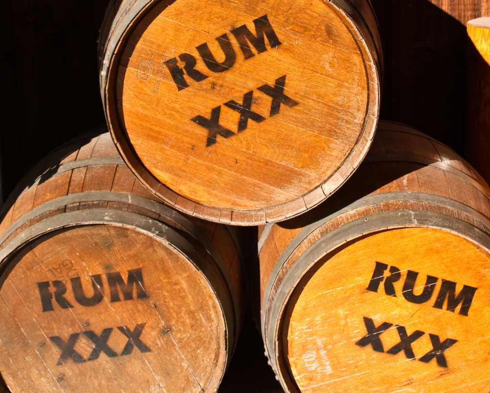 barrels of rum stacked up