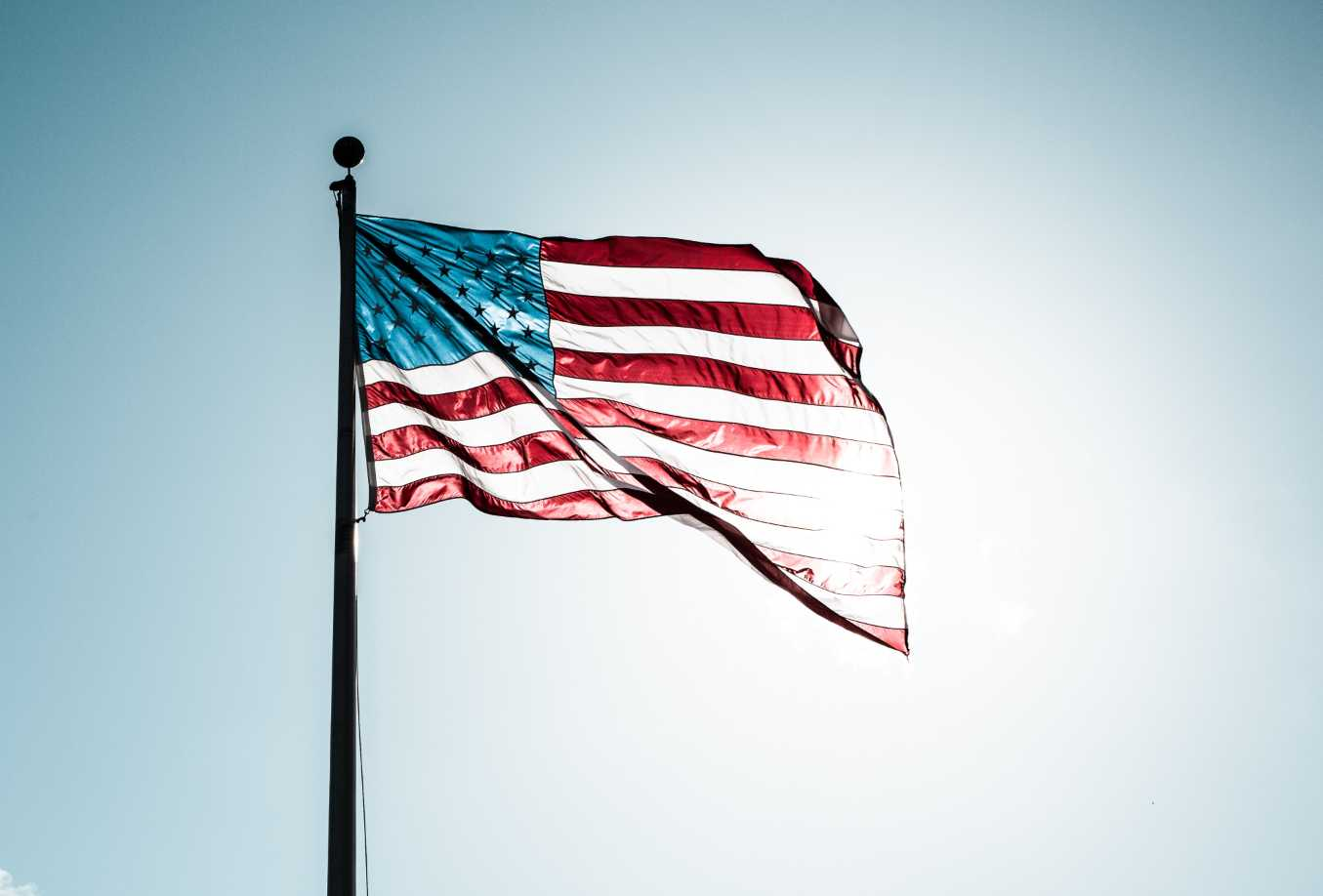 us flag waving on flag pole
