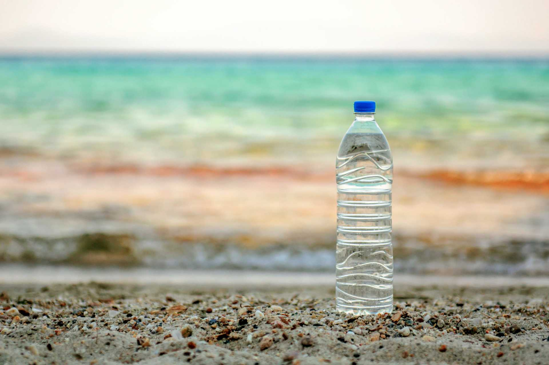water bottle on the beach