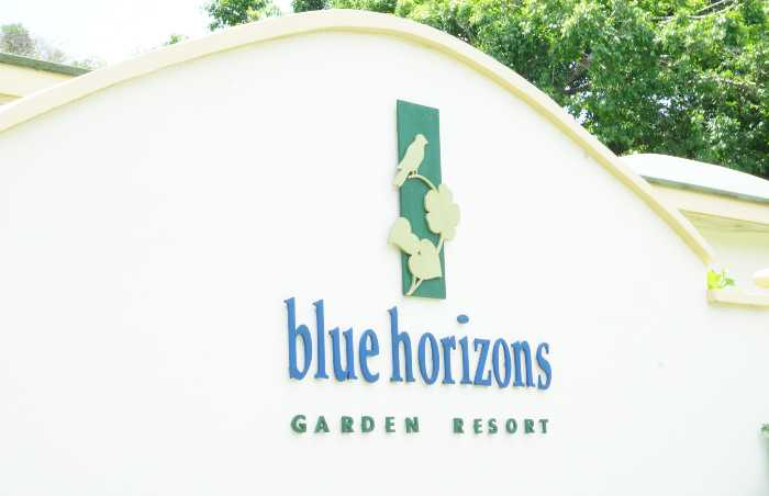 The entrance sign to Blue Horizon Garden Resort