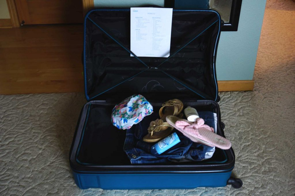 large suitcase opened with items in it
